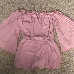 Pink off-shoulder pleated sleeve romper